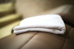 Towel in the spa center on the sunbed close. Rest in the spa center Royalty Free Stock Photography