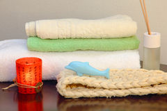 Towel stack with bast and dolphin form soap. Stock Photo