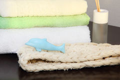Towel stack and bast in the shower. Royalty Free Stock Images