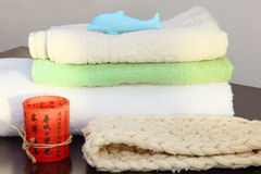 Towel stack and bast in shower. Royalty Free Stock Photography