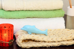 Towel stack, bast and soap. Royalty Free Stock Image