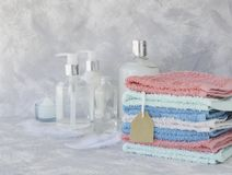 Towel stack with price tag on a white marble background, space for text, selective focus Stock Photography
