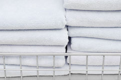 Towel stack on shelf at hotel Royalty Free Stock Photography