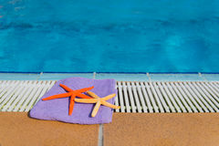 Towel and starfishes Royalty Free Stock Image
