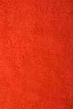 Towel structure. Texture of red bath towel close-up with structure fibers Stock Image