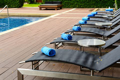 Towel on sun bed at poolside Stock Images