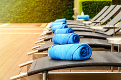 Towel on sun bed at poolside Stock Photo