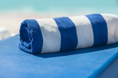Towel on a sun lounger on the beach royalty free stock images