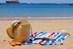 Towel and sunbathing accessories Royalty Free Stock Photo