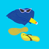 Towel sunglasses flip-flops sunblock. On a bright blue background Royalty Free Stock Photos