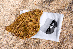 Towel, sunglasses and hat royalty free stock images