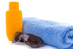 Towel, sunglasses and lotion Royalty Free Stock Photos