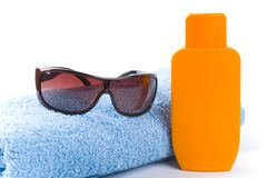Towel, sunglasses and lotion Royalty Free Stock Images