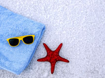 Towel, sunglasses and starfish on a white background. Stock Images