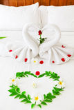 Towel Swan Heart. On the bed - special honeymoon hotel decoration Stock Photo