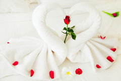 Towel Swan Heart. On the bed - special honeymoon hotel decoration Royalty Free Stock Photo