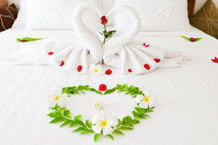 Towel Swan Heart. On the bed - special honeymoon hotel decoration Royalty Free Stock Photos