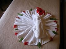 Towel swan in hotel room, top view stock photo
