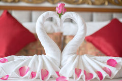 Towel swans on the bed  in hotel Stock Photography