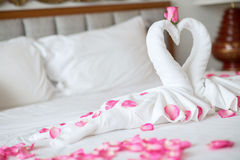 Towel swans on the bed  in hotel Stock Photo