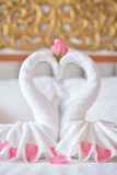 Towel swans on the bed  in hotel Stock Images
