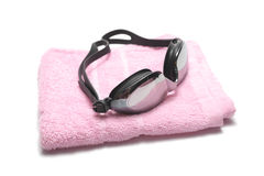 Towel and swimming goggles Royalty Free Stock Image