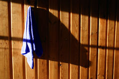 Towel on the wall. Blue towel on the wall with the shadow Royalty Free Stock Photo