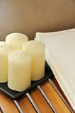 Towel and wax candle for SPA Stock Image