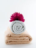 Towel wellness. Rose and white towel with flower Stock Image