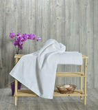 Towel on wood. Image of a high key colorfull towel, simple natural beauty. on wood royalty free stock images