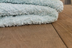 Towel on a wooden table Stock Images