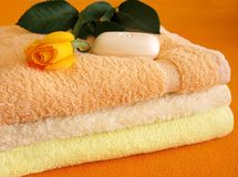 Towel and yellow rose Stock Photo
