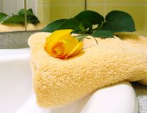 Towel and yellow rose Stock Images