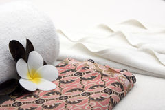 Towel and yellow white tropical flower Stock Images