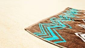 Towell de la playa en la arena Fotografía de archivo