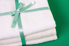 Towels. Beautiful towels wrapped with ribbon Royalty Free Stock Photos