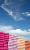 Towels. In different colors with the sky background Royalty Free Stock Image
