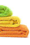Towels. Stacked colorful towels isolated on a white background Stock Image