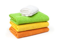 Towels. Stacked colorful towels isolated on a white background Royalty Free Stock Photo