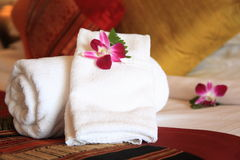 Towels. With orchid flower in a hotel room Stock Image