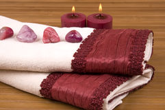 Towels. Luxurious towels, candles, colorful pebbles Stock Images