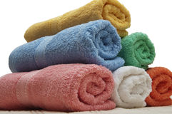 Towels. Colorful rolled towels isolated on white Stock Photo