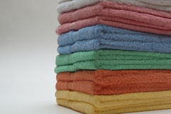 Towels. Soft cotton towels in beautiful colors Stock Photos
