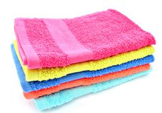 Towels. Of various colors surrounded by white Stock Photography