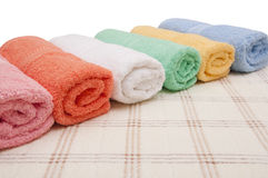 Towels. Soft colorful cotton rolled towels Royalty Free Stock Photos