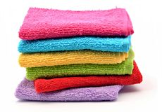 Towels. Of various colors on top of one another surrounded by white background Royalty Free Stock Image