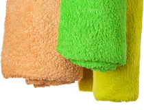 Towels. Three colorful towels are on a white background Royalty Free Stock Photos