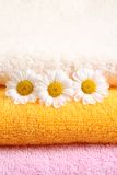 Towels. Stack of towels and nice marigolds - body care stock photography