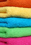 Towels. Stacked colorful towels Stock Photos
