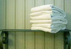 Towels. Clean white towels on a shelf Royalty Free Stock Images